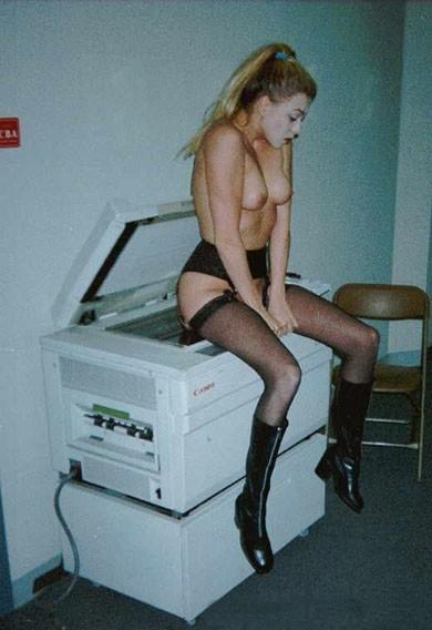 Addetta alla fotocopiatrice sexy